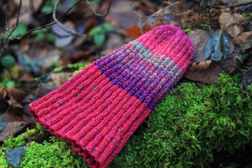 A hand-knit hat of wool, warm and colourful